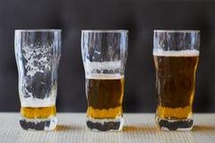 Drie glazen licht bier Royalty-vrije Stock Foto's