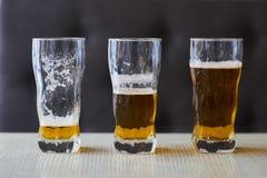 Drie glazen licht bier Stock Foto's