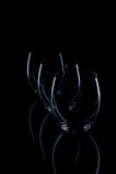 Drie glazen op zwarte achtergrond Royalty-vrije Stock Afbeeldingen