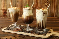 Drie glazen verschillende koude koffiedranken Stock Fotografie