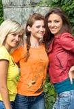 Drie glimlachende vrouwen Royalty-vrije Stock Fotografie