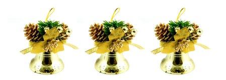 Drie gouden Kerstmisklokken Stock Foto