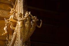 Drie gouden meerminnen Stock Afbeelding