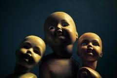 Drie griezelige poppen Royalty-vrije Stock Foto's
