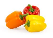 Drie groene paprika's die op wit worden geïsoleerd royalty-vrije stock foto's