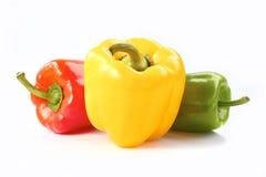 Drie groene paprika's op wit Stock Foto