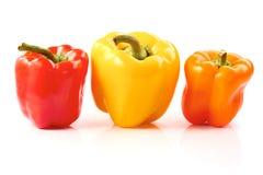 Drie groene paprika's op wit Stock Foto's