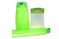 Drie groene schoonheid en hygiëneproducten. Stock Fotografie