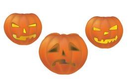 Drie Halloween-Vakantiepompoenen Stock Foto's