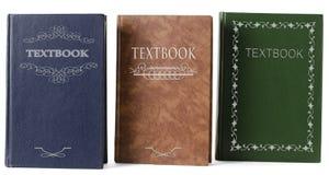 Drie handboeken stock afbeeldingen