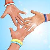 Drie handen op een blauwe achtergrond Royalty-vrije Stock Afbeelding