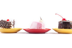 Drie heerlijke multi-colored cakes van horizontaal Stock Foto's