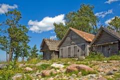 Drie historische houten netto-loodsen Royalty-vrije Stock Fotografie