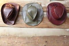 Drie hoeden van de leercowboy Stock Foto