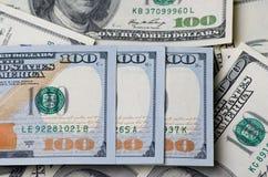 Drie honderd dollars op een stapel van geld als achtergrond Stock Foto's