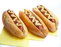 Drie hotdogs Stock Afbeeldingen