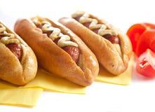 Drie hotdogs met tomaat Stock Fotografie