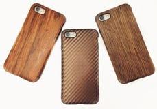 Drie houten iphonegevallen stock foto's