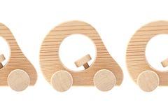 Drie houten stuk speelgoed auto's Stock Foto