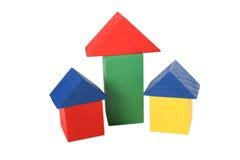 Drie houten stuk speelgoed huizen Royalty-vrije Stock Foto