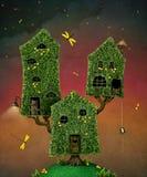 Drie huizen op boom Royalty-vrije Stock Afbeeldingen