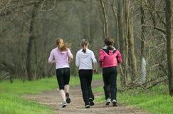 Drie joggers Royalty-vrije Stock Afbeeldingen