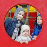 Drie jonge geitjes op een speelplaats Royalty-vrije Stock Fotografie