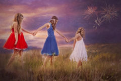 Drie jonge meisjes hand in hand stock foto's