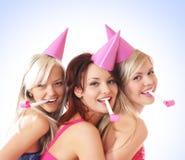 Drie jonge meisjes hebben een verjaardagspartij Royalty-vrije Stock Foto