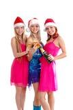 Drie jonge meisjes vieren Kerstmis Stock Foto