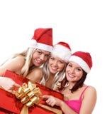 Drie jonge meisjes vieren Kerstmis Stock Foto's