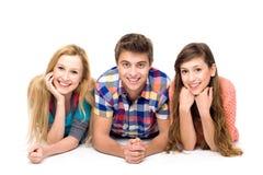 Drie jonge mensen Stock Foto