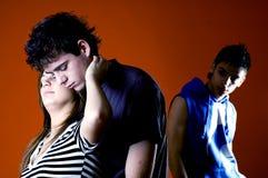 Drie Jonge Volwassenen in Conflict Stock Foto's
