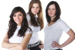 Drie jonge vrouwen Stock Afbeeldingen