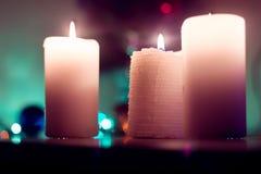 Drie kaarsen Kerstmis Stock Foto's