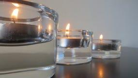 Drie kaarsen op perspectief Stock Afbeeldingen