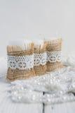 Drie kaarsen op witte lijst Royalty-vrije Stock Foto's