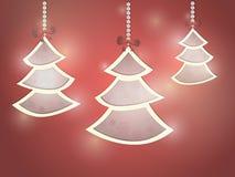 Drie Kerstmisbomen op een rode achtergrond Royalty-vrije Stock Foto's