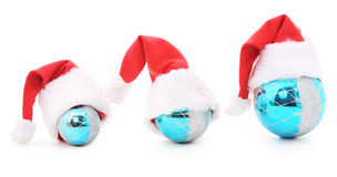 Drie Kerstmisspeelgoed in kappen royalty-vrije stock foto