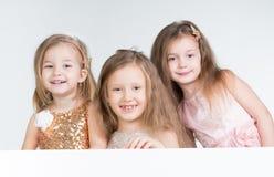 Drie Kinderenmeisje stock fotografie