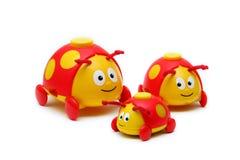 Drie klein insectenspeelgoed voor kinderen Royalty-vrije Stock Foto's