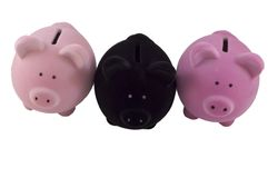 Drie kleine spaarvarkens Royalty-vrije Stock Afbeelding
