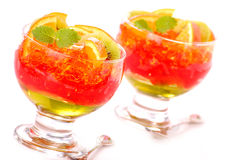 Drie kleurengelei met vruchten Stock Foto