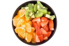 Drie kleurengezondheid, kiwi, mandarijn en aardbeien stock fotografie
