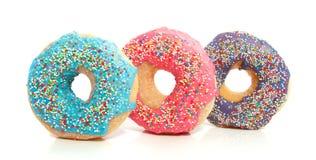 Drie kleurrijke donuts Royalty-vrije Stock Afbeelding