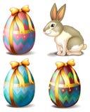 Drie kleurrijke eieren en een leuk konijntje stock illustratie