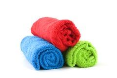 Drie kleurrijke handdoeken Stock Afbeelding
