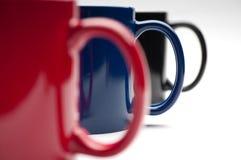 Drie kleurrijke koppen Royalty-vrije Stock Foto's