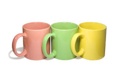 Drie kleurrijke mokken Stock Fotografie