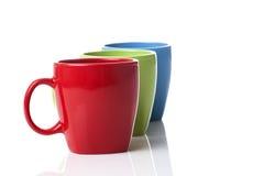 Drie kleurrijke mokken Royalty-vrije Stock Foto